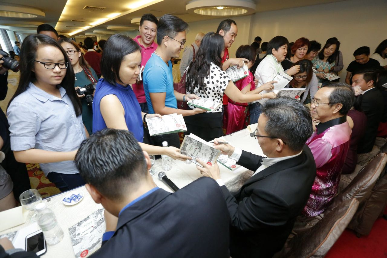 getting signatures on the book, book signature event.