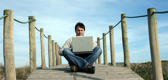 world office, laptop, flexible working hours and jeans